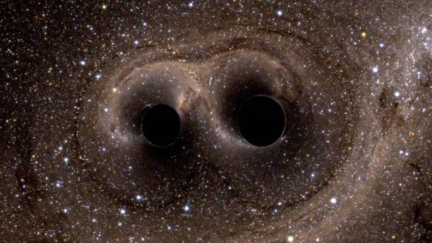 В ближайшем будущем столкнутся две супермассивные черные дыры: пострадает ли от этого Земля